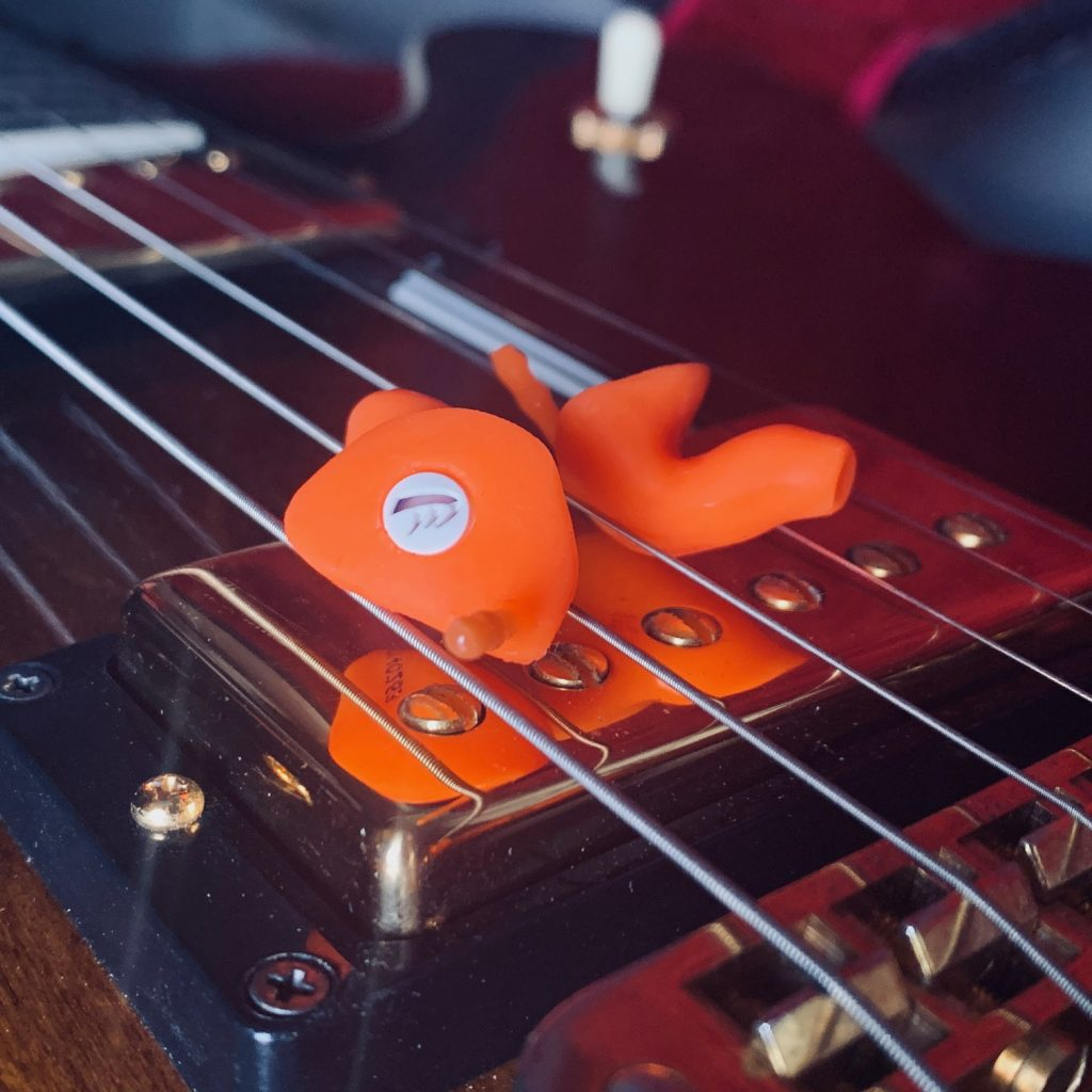 picure of orange custom made musician earplugs on gibson es 347 guitar