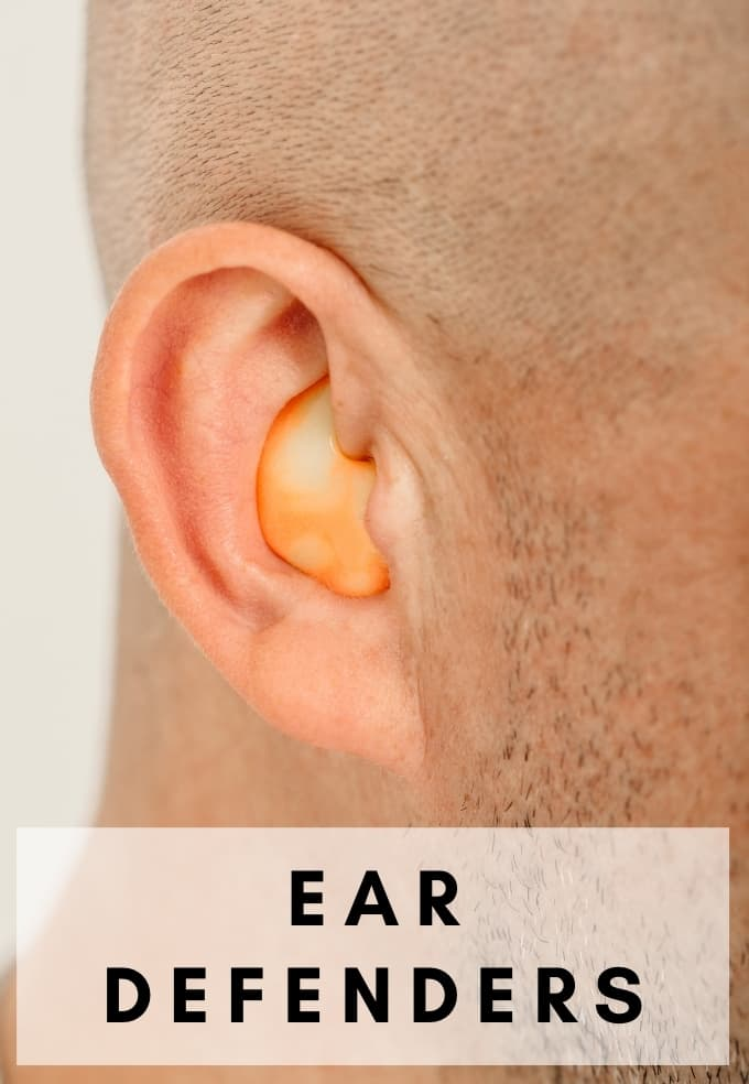 Picture of man wearing custom ear pugs at construction work noise